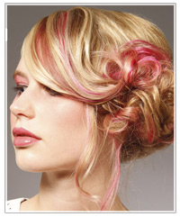 Updo with pink streaks of hair color